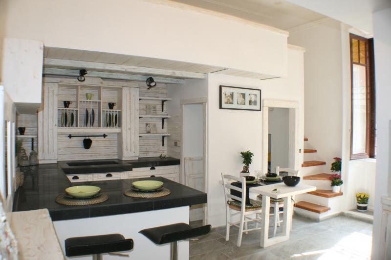 Cucina soggiorno open space piccolo idee per il design for Soggiorno cucina open space